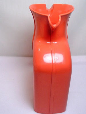 salmon pink Shel Glo double spout pitcher with stopper side