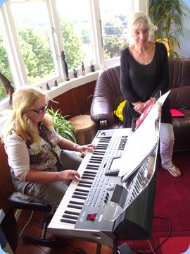 Desiree Barrows playing the Korg Pa3X like a seasoned pro whilst Delyse is watching on absorbed