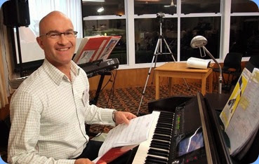 Warrren Levick preparing to play the Clavinova for us in the first half of the programme. Photo courtesy of the Club's photographer, Dennis Lyons.
