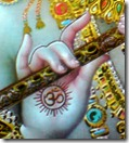 Lord Krishna holding His flute