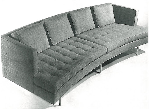 This curved sofa is an endless source of inspiration to me.  I love the shape of it, but I would probably have it reupholstered without buttons to made it a bit more sleek.