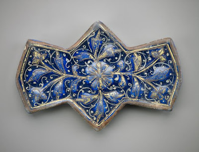 Polygonal tile | Origin:  Rayy,  Iran | Period: 1250-1300  Il-Khanid period | Details:  Not Available | Type: Stone-paste painted over turquoise glaze with gold | Size: H: 15.6  W: 10.4  cm | Museum Code: F1908.165 | Photograph and description taken from Freer and the Sackler (Smithsonian) Museums.