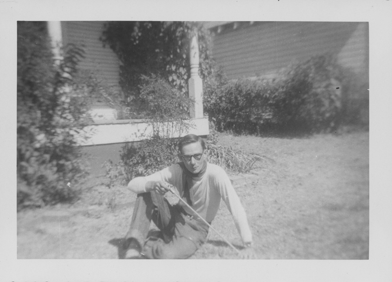 Edgar Sandifer posing outside of a house. Circa 1950s.
