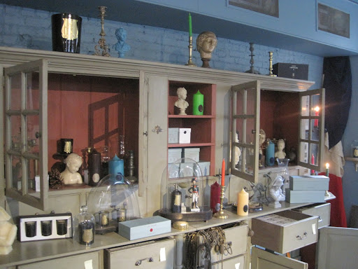 The store incorporates antiques into their displays that are for sale.