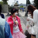 Japanese girl wearing mouthcap in Harajuku, Tokyo, Japan