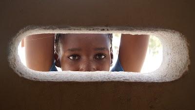 Eyes through cement wall taken by Evan Bartlett