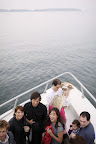 Here, guests and the bride mix and mingle at the front of the ferry boat.