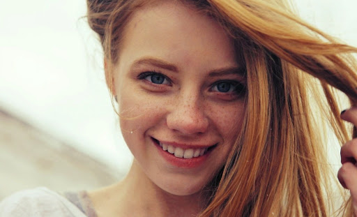 Blue Eyed Girl with Freckles Smiling
