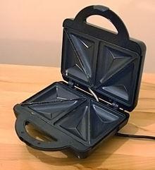 Utensilios de cocina sandwichera la m quina de los sandwich - Como limpiar sandwichera ...