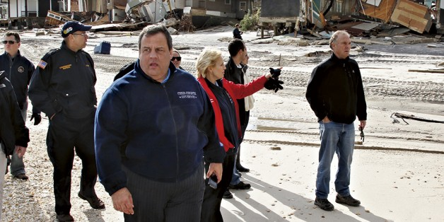 Clarion call? New Jersey Gov. Chris Christie tours the devastation in the wake of superstorm Sandy. Science, storms, and demographics are starting to change minds among the Republican rank and file. Photo: Mel Evans / AP