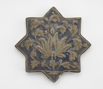 Tile | Origin:  Iran | Period: 14th century  Il-Khanid period | Details:  Not Available | Type: Stone-paste molded and painted under glaze | Size: H: 2.1  W: 20.3  cm | Museum Code: F1903.228 | Photograph and description taken from Freer and the Sackler (Smithsonian) Museums.