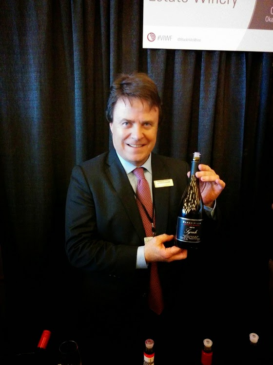 Glenn Fawcett shows off Black Hills' award-winning Syrah