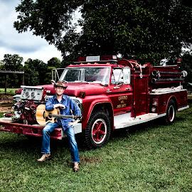 Dan Profitt down on the farm by George Holt - People Portraits of Men ( farm, cowboy boots, cowboy hat, cowboy, guitarist, farmland, firetruck, musician, guitar, fire truck, boots, hat )