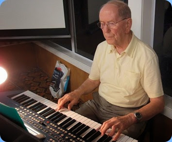 John Beales playing the arrival music on his Korg Pa500. Photo courtesy of Dennis Lyons