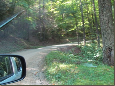 5 mile dirt and gravel narrow road off the mountain....you might meet a motor home coming the other way.