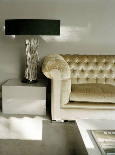 From Citified.blogspot, I love the shimmer the couch provides this living space.