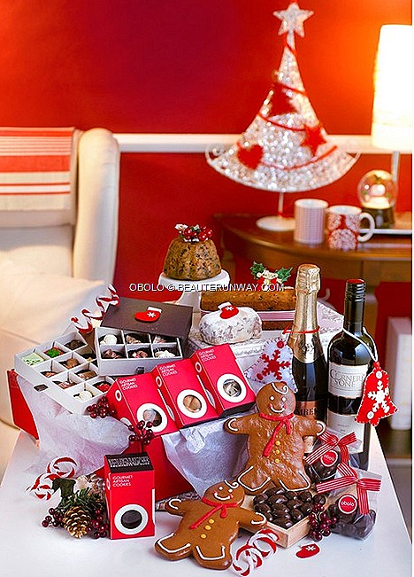 Obolo Christmas Gourmet Food Hampers Traditional fruitcake Christmas pudding stolen Gingerbread man  Gourmet cookies Chocolate pralines Dark chocolate almonds Wine Sparkling juice Tempt $79 Excite $139 Thrill $199 Impress $239
