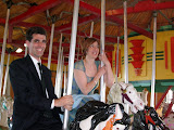 Mike and E'loise on the carousel at 1st beach, Newport
