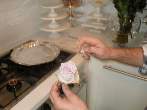 Tom picks off of a few petals to freshen up the look of the Silverstone rose.