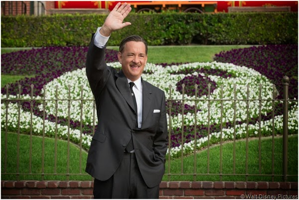 Walt Disney (Tom Hanks) at the front gate of Disneyland.