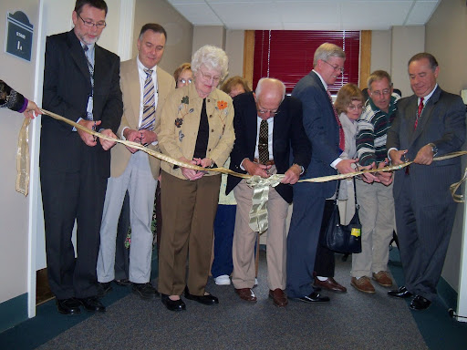 Jim Millard, CEO, the Pfalzer family, and Dr. Alexander Gelfer cut the ribbon of the new SleepCare Center