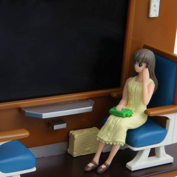 Vagão-Trem-Janela-Passageira-Recarregar-Smartphone-Detalhe-Display