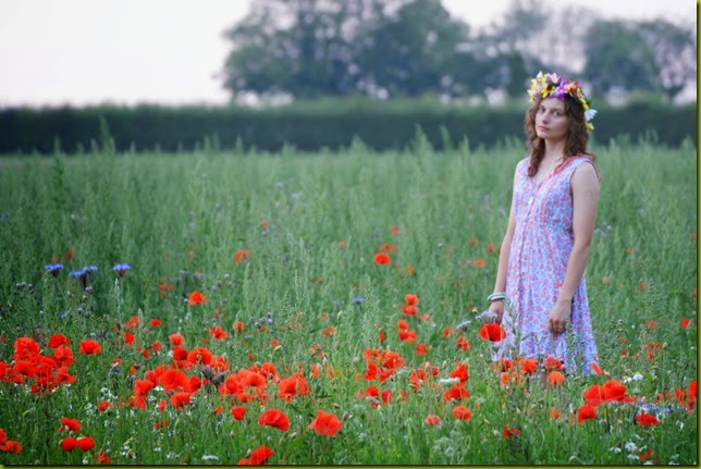 girl standing in wild flowers