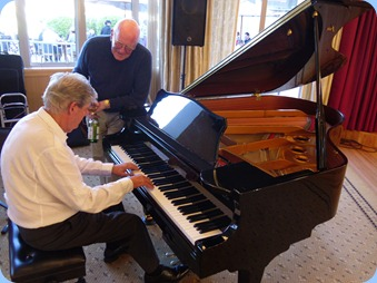 Ian Jackson also played during Happy Hour on the grand piano whilst Carey Forrest watches on.