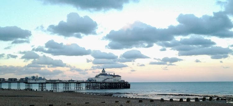 Fluffy clouds over Eastbourne pier_thumb[2]