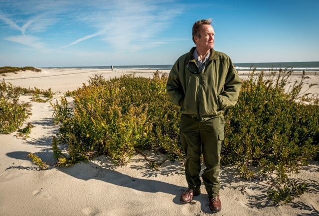 National Park Service Chief of Maintenance for Assateague Island National Seashore, Ish Ennis, stands along the natural dunes on Assateague Island, Maryland, on 18 November 2014. Photo: J.M. Eddins Jr. / The Washington Post