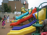 The many slides of Robot Park. That&#039;s Maria in the blue jacket, with Eidan next to her.