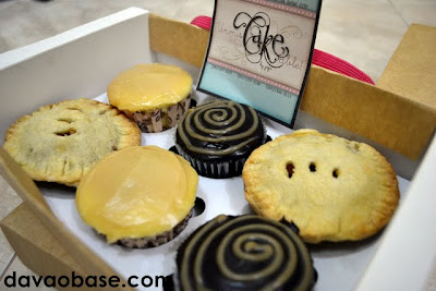 Six pastries in a box from UnmisCAKEable by Jaja: White Temptation, Dark Decadence, and Classic Apple Pie