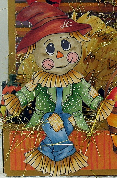 fall into autumn scarecrow close up