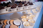 Tribeca Treats made beautiful metallic sweets -- chocolate cookies with metallic icing and mini cupcakes with teeny silver dragees.  Wrapped up in a Bella Cupcake Couture metallic wrapper. No guest could resist!