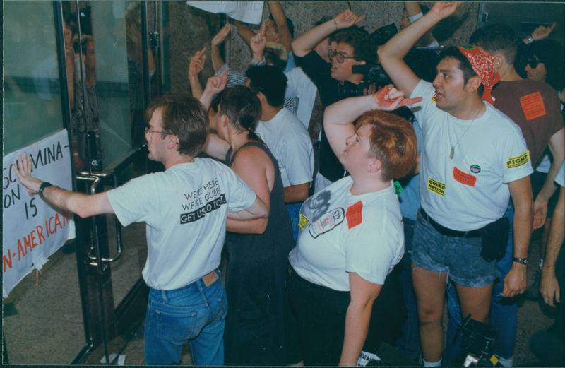 Queer Nation protests at the Reagan Federal Building in Los Angeles. Vaughn Taylor was arrested at this protest. October 1991.