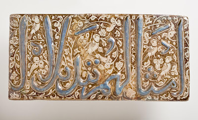 Tile | Origin: Iran, Kashan | Period:  circa 1300-1310 | Collection: The Nasli M. Heeramaneck Collection, gift of Joan Palevsky (M.73.5.142) | Type: Ceramic; Architectural element, Fritware, overglaze luster-painted with cobalt blue, 7 7/8 x 16 in. (20 x 40.64 cm)