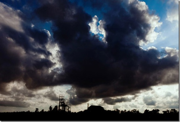 Clouds are rising over the former Union Carbide (now DOW Chemical) factory in Bhopal, Madhya Pradesh, India, site of the infamous 1984 gas disaster.
