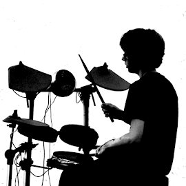 Autistic child drummer by Yorkshire Pudding - People Musicians & Entertainers ( autistic, percussion, black and white, drums, boy )