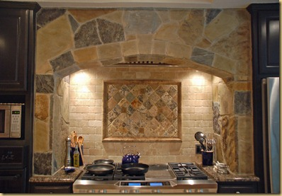 stone arch over stainless range
