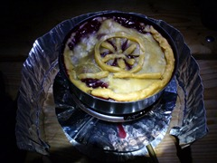 Pie on a campstove. Bike wheel decoration included.