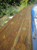 Here is what the varnish does... protect the teak from water!
