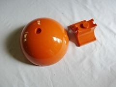 Small orange plastic footed bowl