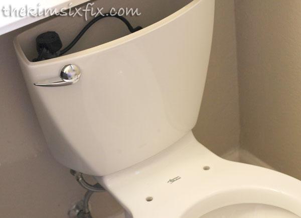 Installing toilet tank