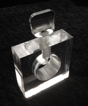 Lucite nut cracker oblique