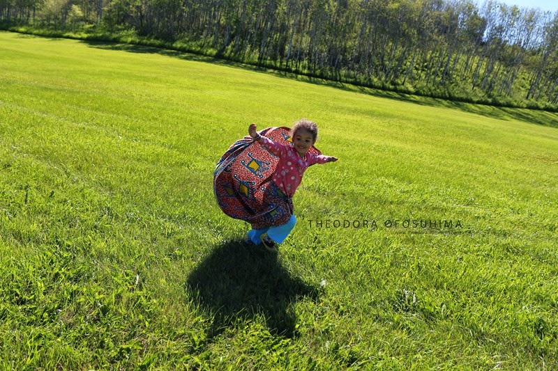theodora ofosuhima running toddler kite