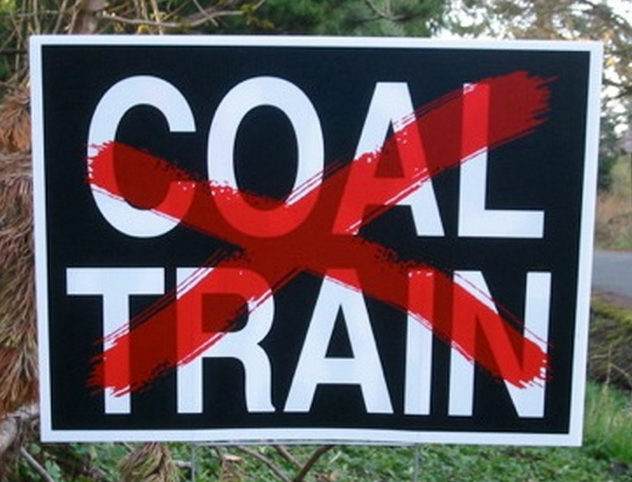 A yard sign has 'Coal Train' crossed out with a red X. A coalition of Washington state cities and tribes opposes shipping large volumes of coal through the state to a 'superport' for export to China. Photo: seattlemet.com