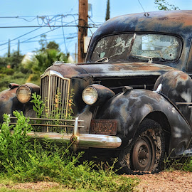 Tombstone, AZ by Tricia Marchlik - Transportation Automobiles ( tombstone, grill, arizona, tires, bullet holes,  )