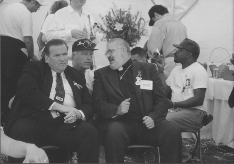 Dave Mixner and Reverend Troy Perry talk backstage at the March on Washington. 1993.
