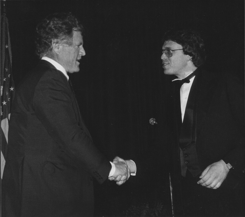 U.S. Senator Ted Kennedy shakes the hand of MECLA board member Michael Nicola at the MECLA (Municipal Elections Committee of Los Angeles) Banquet. April 23, 1982.