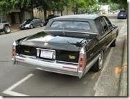 1991_Cadillac_Fleetwood_gold-edition_black_rr
